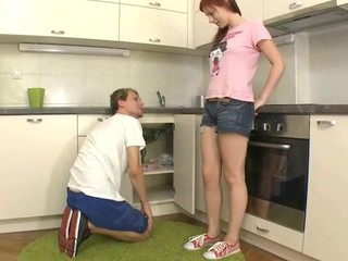 Beauty spreads open her legs at the kitchen for wild satisfying