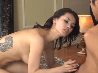 The cute Oriental honey is fond of being double permeated