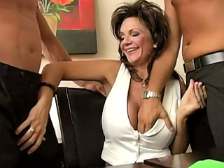 Busty brunette getting drilled hard by two guys at work