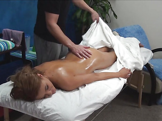 Sex appeal beauty becomes totally stripped and then lies on a massage table. Dude starts massaging wonderful-looking sporty body of the cutie with oil and that babe becomes turned on so much from the massage.