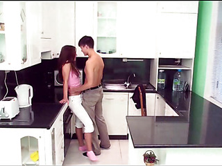 Longhaired redhead playgirl gets orgasms from sex in the kitchen