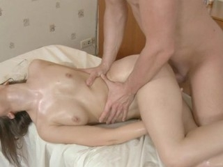 Rubbing oil on sexy darling makes her hungry for fucking