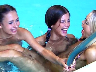 Steamy hawt legal age teenager lesbians giving a kiss & fingering in the pool!