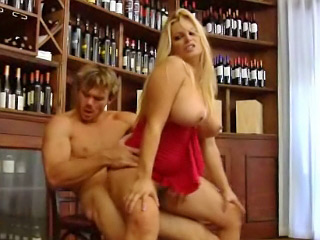 Busty blue eyed blonde babe licks the head of a big swollen cock